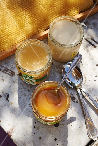 Jars of honey and a honeycomb