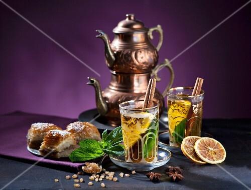 Tea Eastern-style with mint, cinnamon, orange and baklava