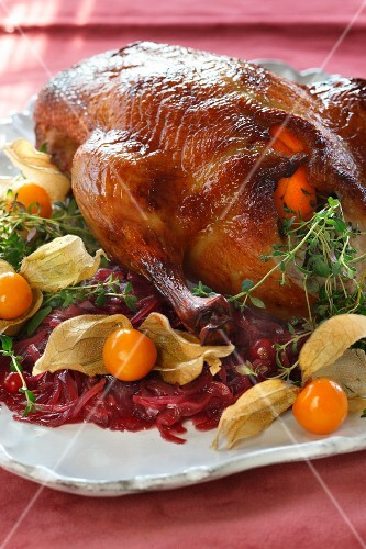Stuffed duck with tangerines and caramelised onions