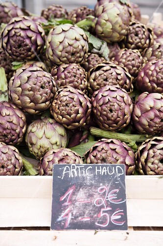 Artichokes at the market with price label