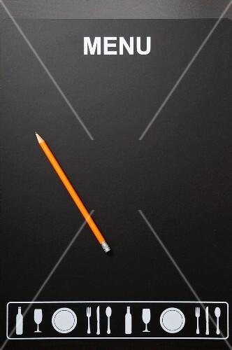 A menu board with a pencil