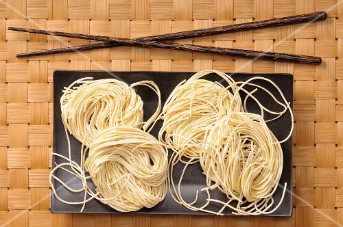 Egg noodles and chopsticks