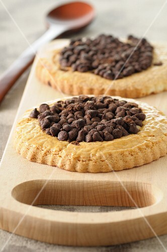 Biscuits with chocolate chips on a chopping board