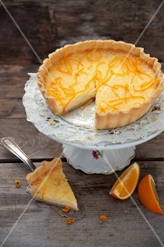 Orange tart, one slice cut