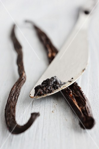 A vanilla pod and seeds which have been scraped out