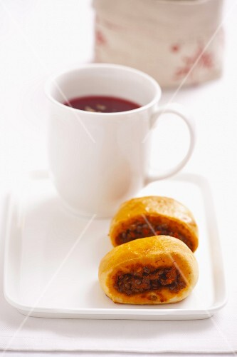 Yeast-risen pastries with lentil and tomato filling, served with a mug of borscht