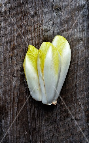 Chicory on a rustic wooden surface