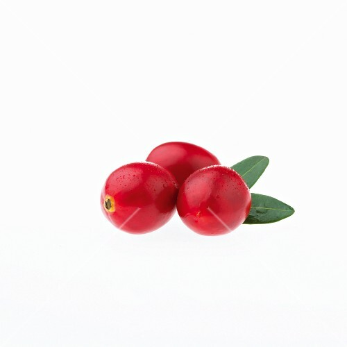 Three cranberries with water droplets