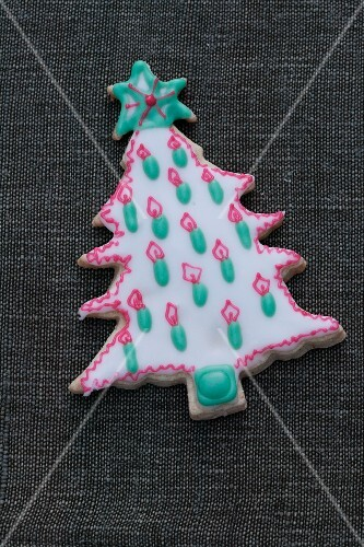 A decorated biscuit in the shape of a Christmas tree