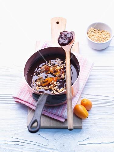 Date and kumquat jam in a saucepan