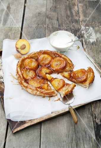 Peach tarte tatin, partly sliced