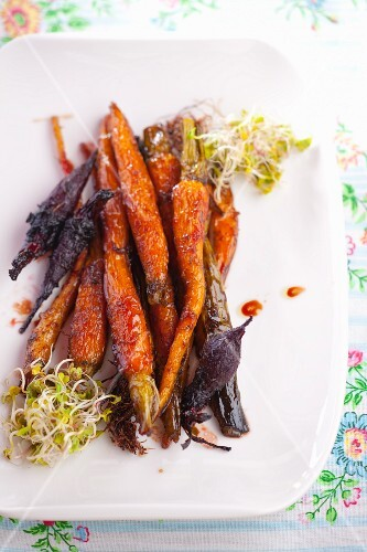 Barbecued carrots and beetroot, garnished with sprouts