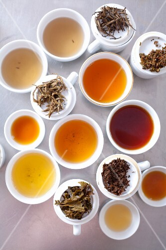 An assortment of brewed teas and tea leaves