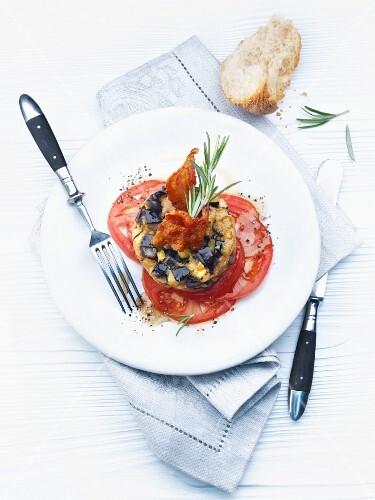 Eggplant-zucchini towers on tomato carpaccio