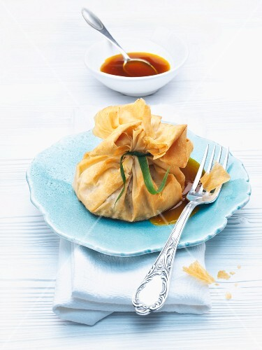 Filo dough pouches filled with duck