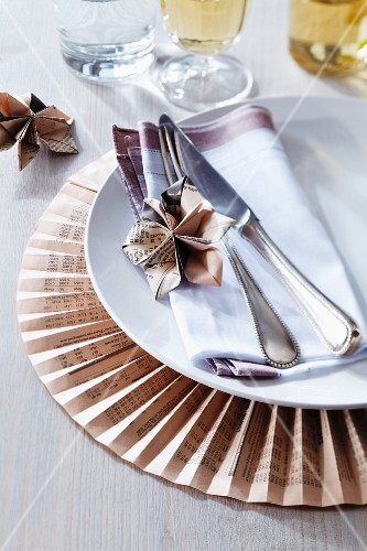 Place mat & plate decorations made from folded newspaper