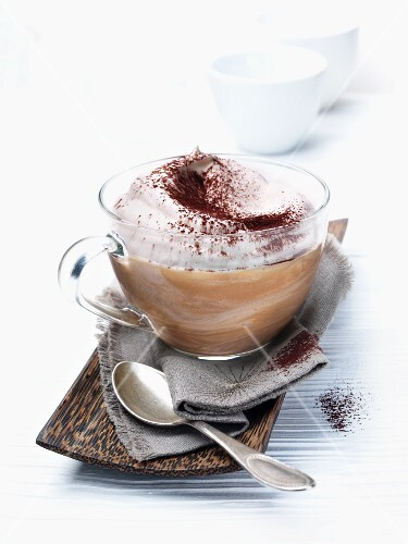Coffee mousse with cream and cocoa powder