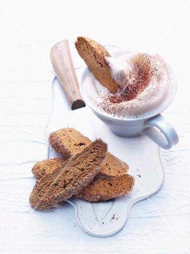 Cantuccini and espresso with milk foam