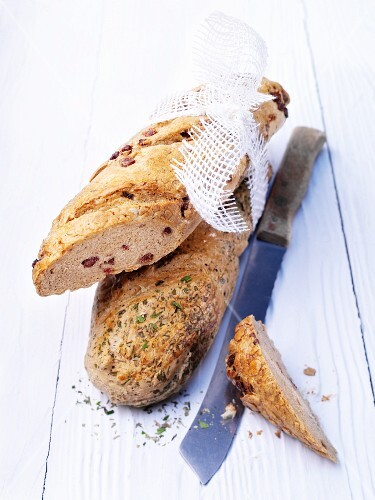 Bacon bread and herb bread with a bread knife