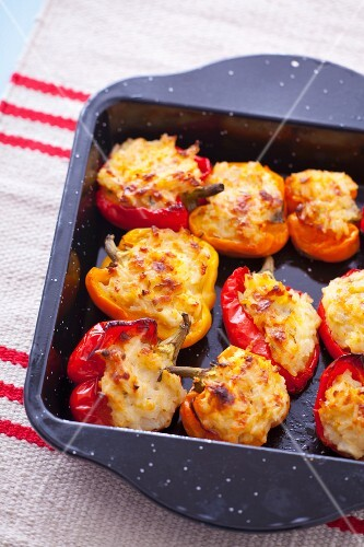Red peppers stuffed with rice and cheese
