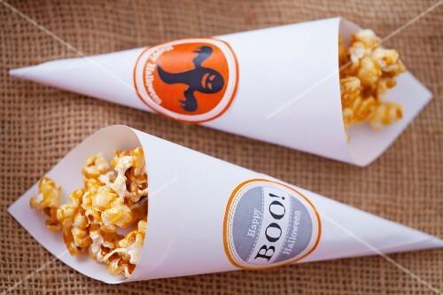 Caramel popcorn in paper cones for Halloween