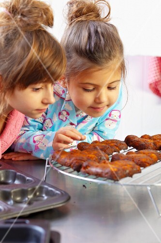 Two girls looking at freshly baked carrot cakes