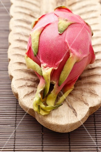 Dragon fruit on a wooden serving platter
