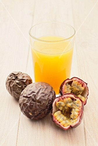 Passion fruit juice and fresh red passion fruit