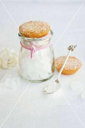 Flavoured rock candy in a jar with a coconut cake as a lid