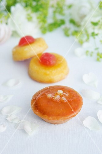 Sponge biscuits with jam and cocktail cherries