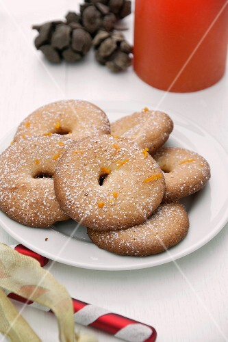 Orange sables (cookies) on a plate