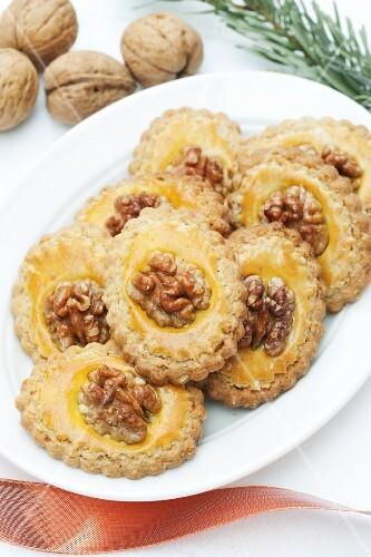 Walnut pangani (Italian butter cookies) on a plate