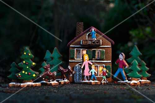 A Christmas scene with a gingerbread house
