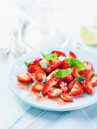 Strawberry salad with basil and lemon juice