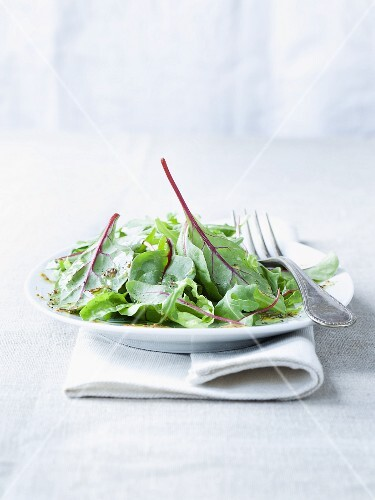 A salad of young chard leaves with a honey and mustard dressing