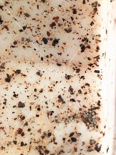 Lardo (cured fatback) with spices (close-up)