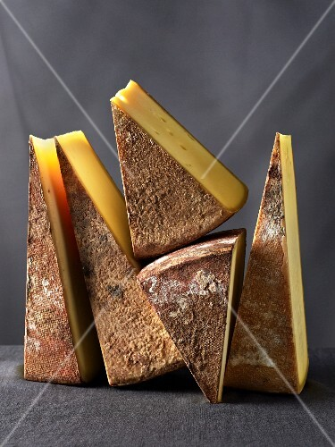 Several wedges of Vorarlberger Bergkäse cheese