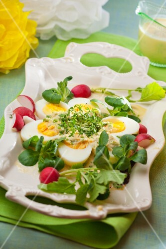 Hard-boiled eggs with horseradish, radishes, lamb's lettuce and cress for Easter