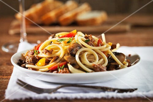 Perciatelli Pasta with Sausage, Mushroom and Thyme in a White Wine Sauce