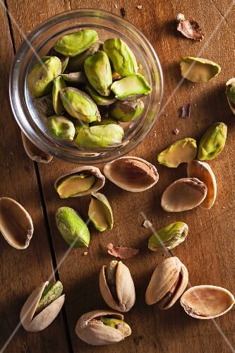 Shelled Pistachios in a Bowl; Pistachio Shells