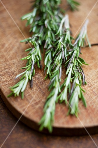Fresh rosemary on a wooden board