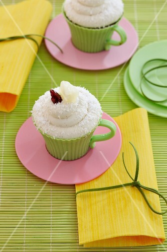 Pineapple and coconut cupcake with cranberry