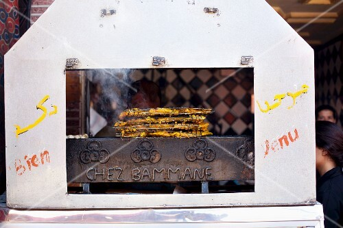 A stall selling barbecued food at a market in North Africa