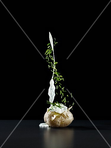 Foil-baked jacket potato with a splash of chive quark