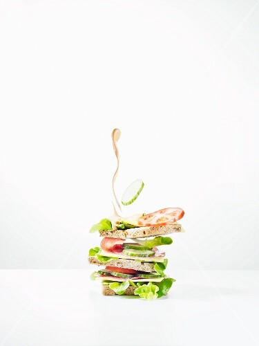 A sandwich with a splash of mayonnaise