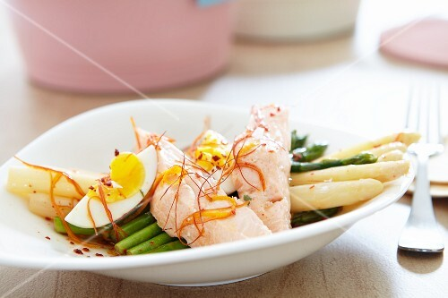 Green and white asparagus with salmon trout and a boiled egg