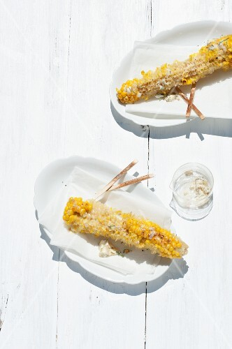 Remnants of barbecued corn on the cob on plates