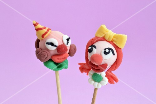 Cake pops decorated to look like clowns