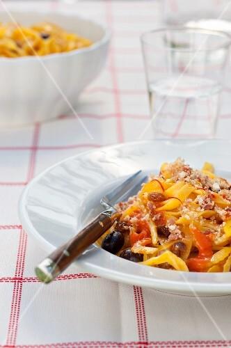 Tagliatelle with tomato sauce, black olives, fennel and saffron threads