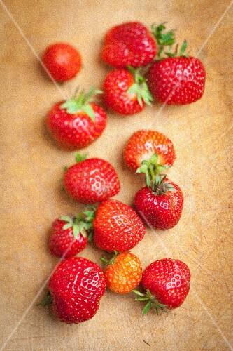 Fresh strawberries on a wooden board